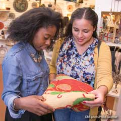 Two young women shopping at a local boutique
