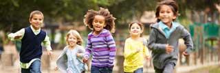 Happy children running in a park