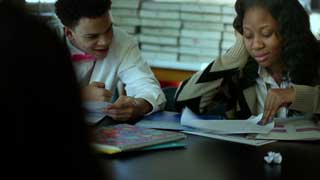 Two Christo Rey students study together