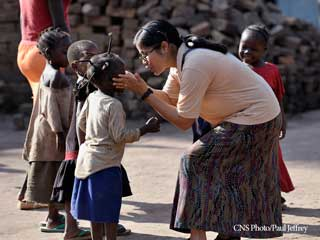 A woman interacting with African children
