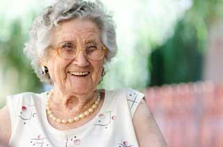An elderly woman smiling