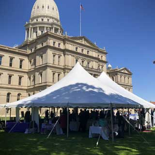 Attendees at the Empowering Women, Strengthening Communities event held on the Capitol lawn