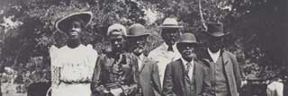 Six Black Americans participating in an Emancipation Day (Juneteenth) celebration in 1900 in Texas.