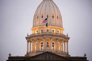 The dome of the Michigan State Capital building seen from the outside at dusk