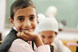 Middle Eastern children in a school classroom