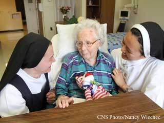 Nuns and an elderly woman in the hospital