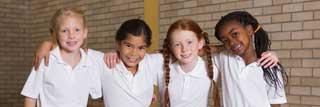 Four children dressed in school uniforms