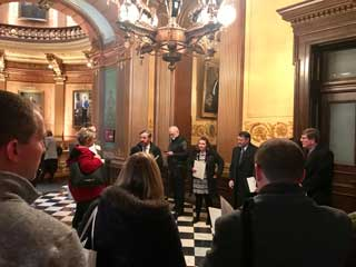 MCC Vice President for Public Policy Tom Hickson guides nonpublic school principals to Senate session and helps them pull lawmakers off the Senate floor for individual legislative meetings.