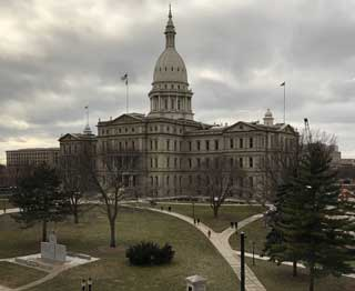 The Michigan State Capitol Building on a cloudy day