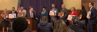 Attendees of a press conference at the Michigan Capitol with a bipartisan group of State Senators who support Raise the Age legislation