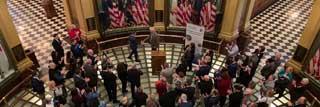 Michigan nonpublic school educators attending a Public Policy Day event in the Michigan State Capitol Building rotunda