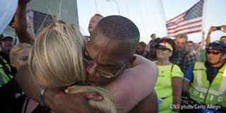 Two protestors hugging
