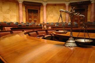 The scales of justice in a courtroom