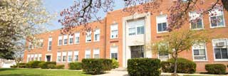 The front of a school building in spring