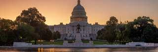 The sun setting on the U.S. Capital Building